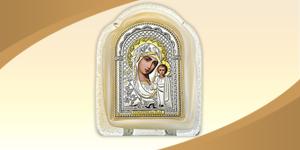 Икона с образом Казанской Богородицы. Оклад иконы изготовлен из листового серебра. Основание муранское стекло, золотистого или белого цвета.
