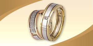 Парные обручальные кольца с бриллиантами из комбинированного золота
